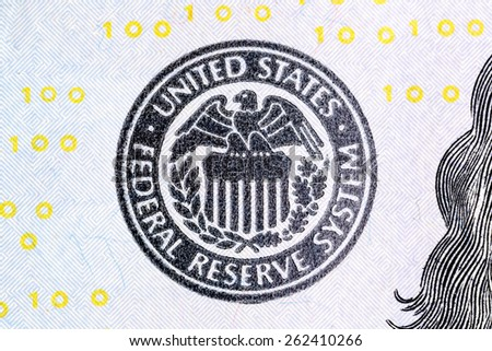 Macro shot of United States Federal Reserve System sign on new 100 dollar bill. - stock photo
