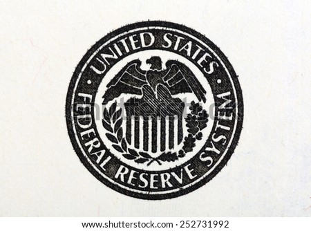 Macro shot of United States Federal Reserve System symbol on old 100 dollar bill. - stock photo