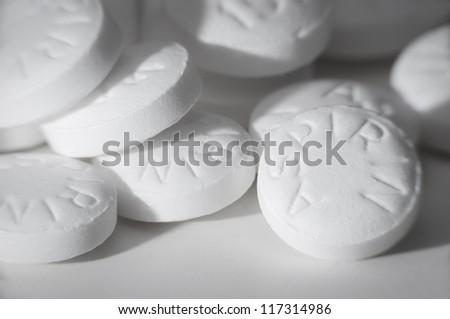 Macro shot of white asiprin on white background. - stock photo
