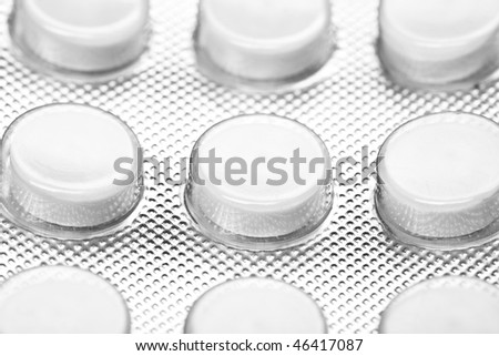 Macro shot of white  pills` set  isolated on white backround