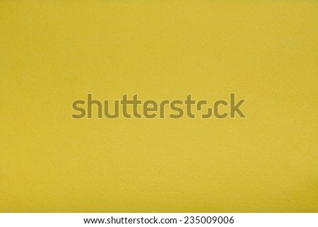 Macro shot of yellow felt tissue cloth, closeup texture background with details in structure. - stock photo