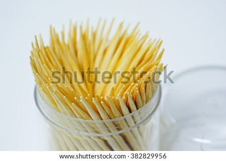 Macro shot Toothpick on white table background:select focus with shallow depth of field. - stock photo