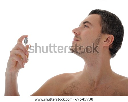 macro shot young male spray perfume on his skin. isolated on white background - stock photo