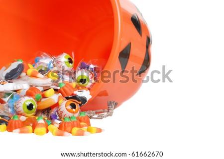 macro spilled Halloween candy and pumpkin bucket - stock photo