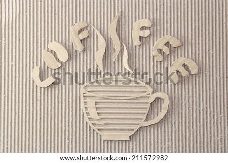 Macro texture of corrugated fiberboard hot cup of coffee and C O F F E E cutting  - stock photo
