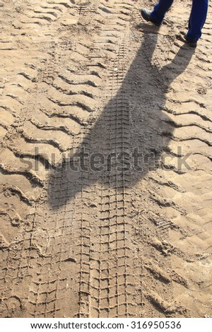 macro texture tire tracks in the sand - stock photo