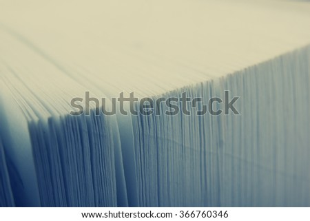Macro view of book pages. Toned image. Copy space for text - stock photo