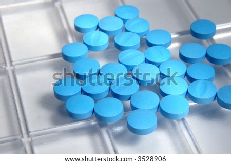 macro view of cyan pills from above