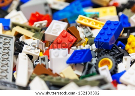 Macro view of heap of color plastic toy bricks. Selective focus effect - stock photo
