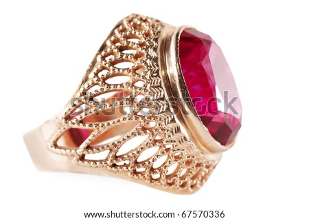 Macro view of old golden ring with red gem. - stock photo