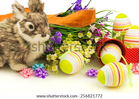 Macro view of rabbit, easter eggs and flowers  isolated on white background - stock photo