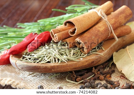 Macro view of the different spices on wooden background (shallow dof) - stock photo