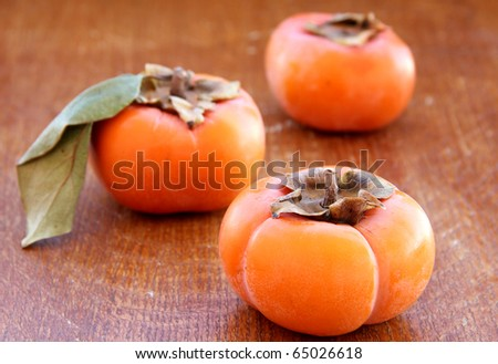 macro view of the persimmons on the wood texture - stock photo