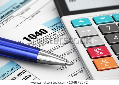Macro view of 1040 US Tax Form, calculator and ballpoint pen - stock photo