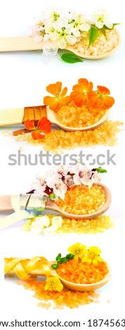 Macro view of wooden spoons with color bath salt and flowers isolated on white background - stock photo