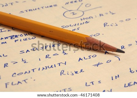 Macro view of yellow pencil and class notes from general relativity on yellow paper - stock photo
