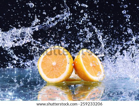 Macro water splash on lemon. Water drops with juicy lemon - stock photo