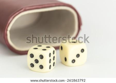 Macro white dice isolated on white background - stock photo