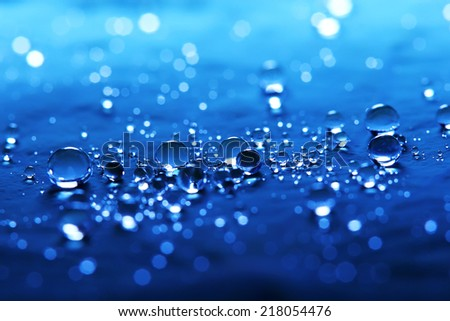 Macro with blue water drops on lotus leaf close up - stock photo
