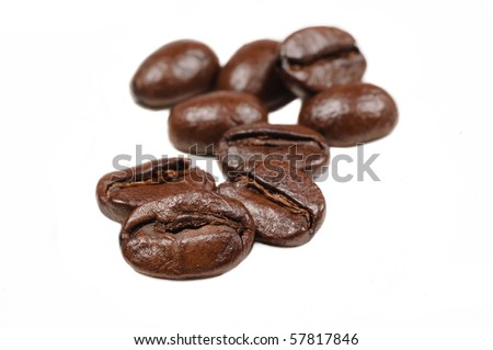 Macro with shallow depth of field of coffee beans on  white background - stock photo