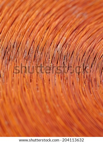 Macrodetail of a copper inductor in a transformer. - stock photo