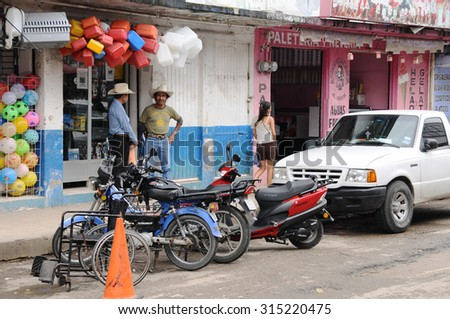 MACUSPANA, MEXICO - JANUARY 10, 2015: People in the street on January 10, 2015 in Macuspana, Mexico. Macuspana is the the fifth-largest city in Tabasco state