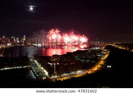 Macy's fireworks on 4th of July 2009. View from New Jersey to Manhattan. - stock photo