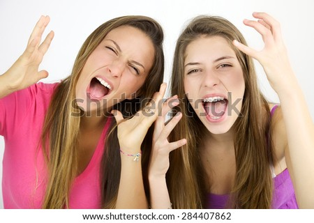 Mad female teenager shouting loud desperate