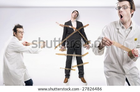 Mad scientist and bound businessman - stock photo