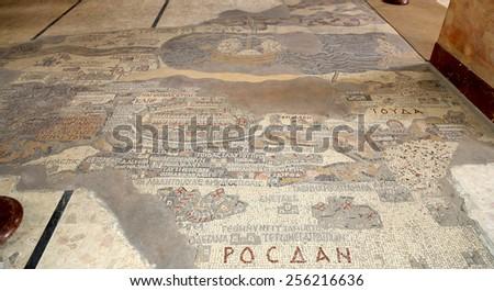 MADABA, JORDAN - APRIL 07. 2014: ancient byzantine map of Holy Land on floor of Madaba St George Basilica, Jordan, Middle East - stock photo