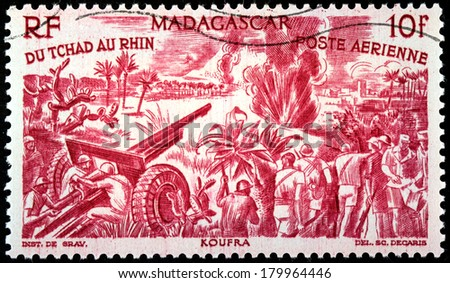 MADAGASCAR - CIRCA 1946: A postage stamp printed by MADAGASCAR shows Free French Forces in the Battle of Koufra, North Africa (1941), circa 1946 - stock photo