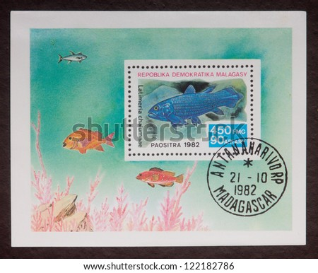 MADAGASCAR - CIRCA 1982: A stamp printed in Madagascar shows fishes of different kinds, circa 1982. - stock photo