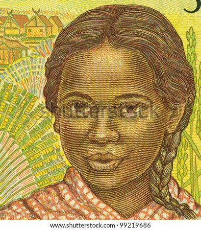 MADAGASCAR - CIRCA 1995: Girl on 500 Francs 1995 Banknote from Madagascar.