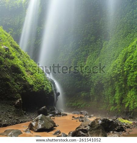 Madakaripura Waterfall â?? Deep Forest Waterfall in East Java, Indonesia - stock photo
