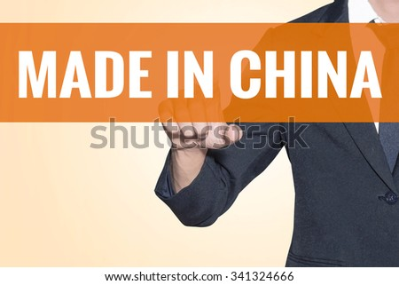 Made in China word Business man touch on virtual screen orange background - stock photo
