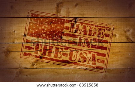 Made in the USA rubber stamp on wooden background
