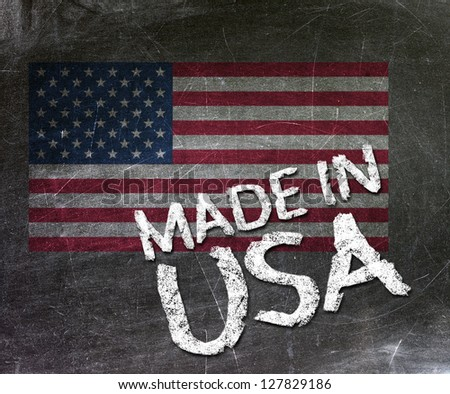 Made in USA handwritten with white chalk on a blackboard. - stock photo