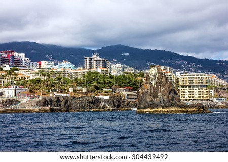 Madeira island, Portugal. Seafront houses, Funchal town. - stock photo