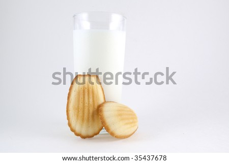 Madeleines with glass of milk - stock photo