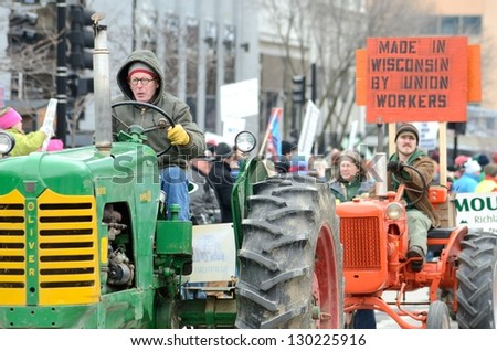 MADISON, WI - MARCH 12:Farmers in Wisconsin rally against Governor Scott Walker's budget bill on Mar 12 , 2011. Walker has won the recall election, but he still faces a new election next year - stock photo