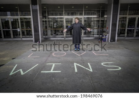 MADISON, WISCONSIN USA - JUNE 7: A judge on the steps of the City County Building Wisconsin's gay marriage ban was struck down June 7, 2014 in Madison, WI - stock photo