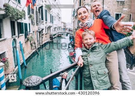 Madly happy family take a selfie photo on the one of bridge in Venice - stock photo