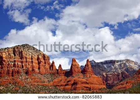 Madonna Nuns Orange Red Rock Canyon Big Blue Cloudy Sky Green Trees Snow Sedona Arizona - stock photo