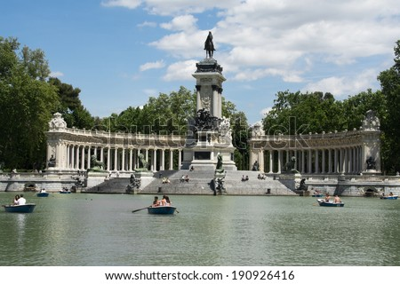 MADRID - APRIL 30: People enjoy a sunny day in Retiro Park on April 30, 2014 in Madrid, Spain. This park is the largest one of Madrid.