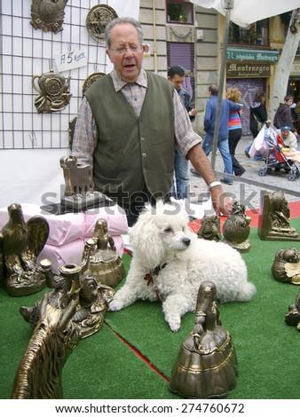 Madrid-August 7,  Unidentified vendor of souvenirs on flea market  EL Rastro  on August 7  2005 in Madrid - stock photo