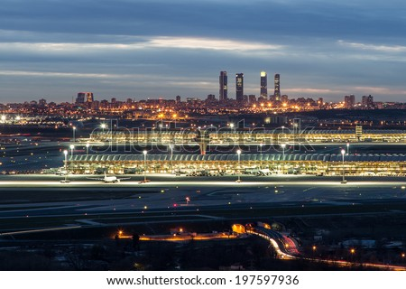 Madrid-Barajas Airport with the Four Towers Business Area at the background - stock photo