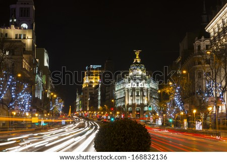 MADRID - DECEMBER 21: Night view of Madrid's Alcala and Gran Via streets illuminated by the traffic and the Christmas decorations, on December 21, 2013.