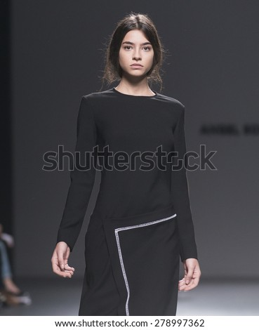 MADRID - FEBRUARY 09: a model walks on the Angel Schlesser catwalk during the Mercedes-Benz Fashion Week Madrid Fall/Winter 2015 runway on February 09, 2015 in Madrid.  - stock photo