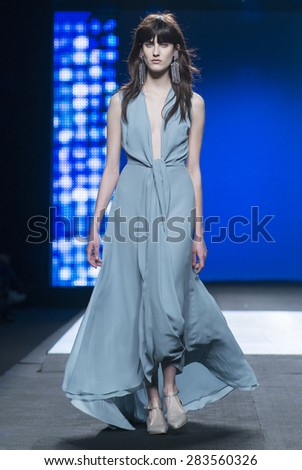 MADRID - FEBRUARY 07: a model walks on the Duyos catwalk during the Mercedes-Benz Fashion Week Madrid Fall/Winter 2015 runway on February 07, 2015 in Madrid.  - stock photo