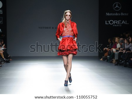 MADRID - FEBRUARY 01: A model walks on the Victorio & Lucchino catwalk during the Mercedes-Benz Fashion Week Madrid runway on February 01, 2012 in Madrid, Spain. - stock photo